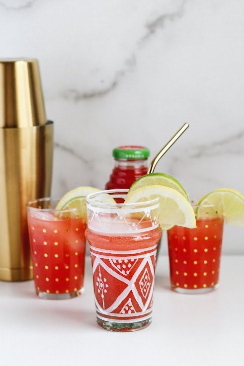 A glass of Spiced Wonder Melon Vodka Punch recipe