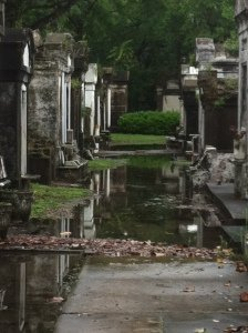 Flooded walkway in Lafayette Cemetery No 1 in New Orleans