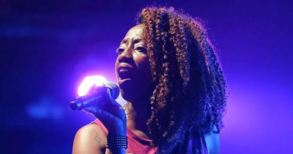 New Orleans Musician, Erica Falls sings on stage