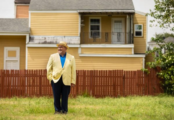 John 'Papa' Gros stands in a grassy yard
