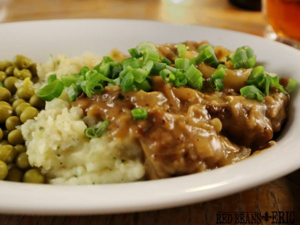 Hamburger Steak with Smothered Onions by Red Beans and Eric. Seved with homemade mashed potatoes and peas.