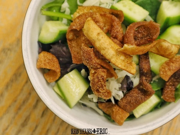 A salad bowl of Creole Seasoned Fried Wonton Strips