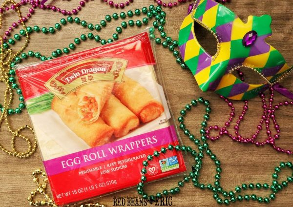 Package of Twin Dragons Egg Roll Wrappers with Mardi Gras beads.