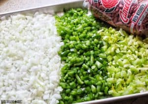 The Holy Trinity of Creole and Cajun cooking: diced onions, green bell peppers, and celery. There's also a bag of Camellia brand red beans.