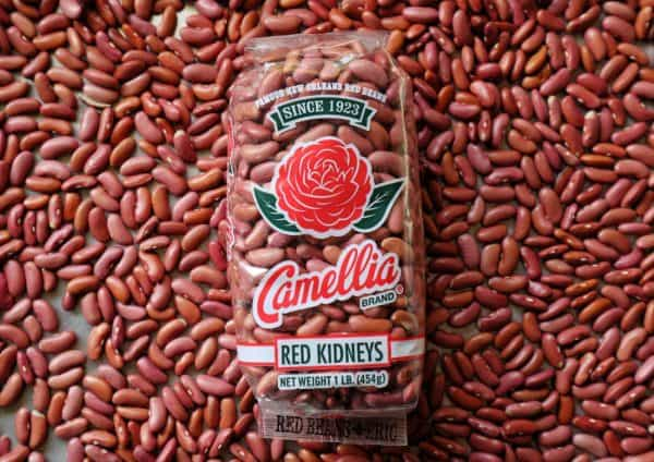 A bag of Camellia brand red beans surrounded by red beans.