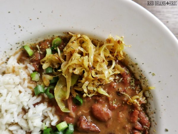 Sautéed Cabbage in a bowl with Red Beans and Eric's Monday Night red beans and rice.