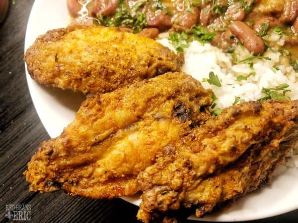 Crispy oven chicken wings with a plate of red beans and rice by Red Beans and Eric